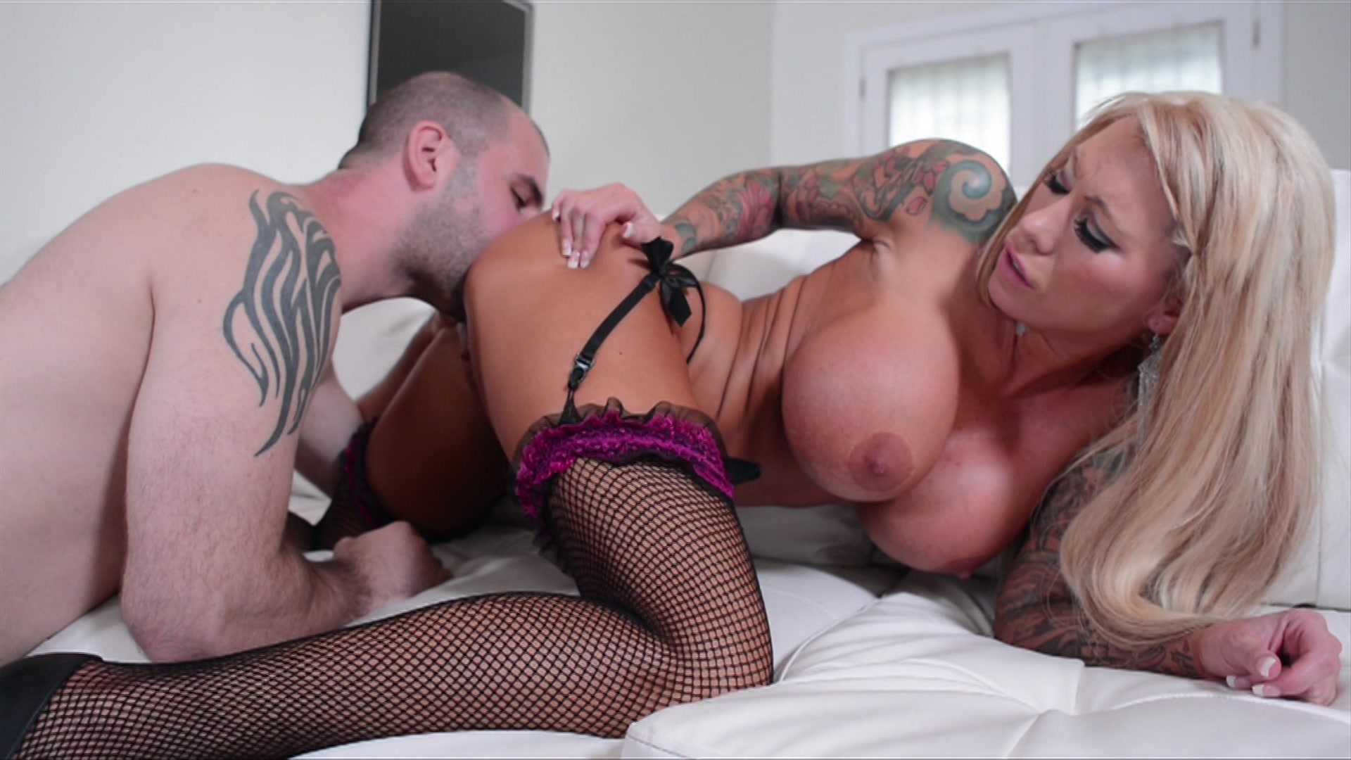 Super Busty Blonde in Fishnets Lolly Ink Takes His Big Cock on the White Couch Starring:  Lolly Ink