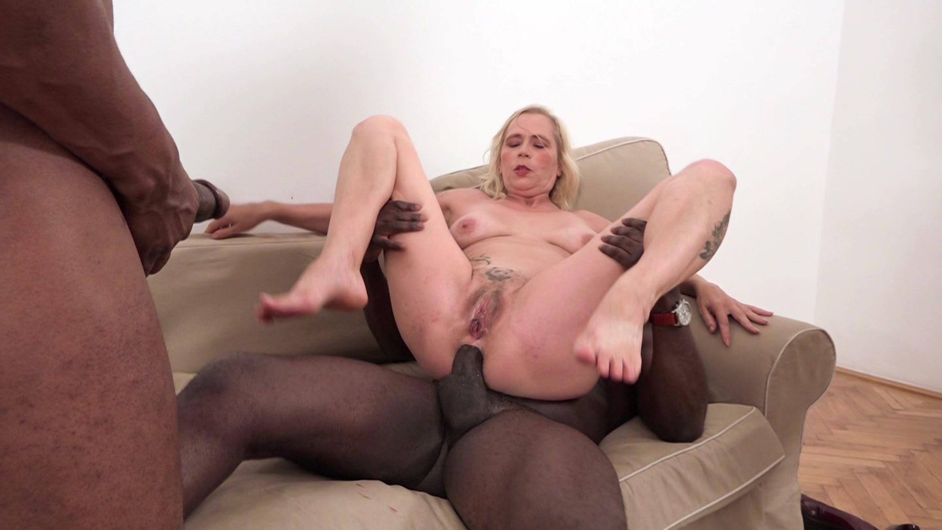 Mature granny w big tits fucks big black cock in interracial photo