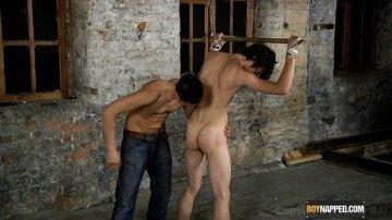Bondaged gays cocks stroking