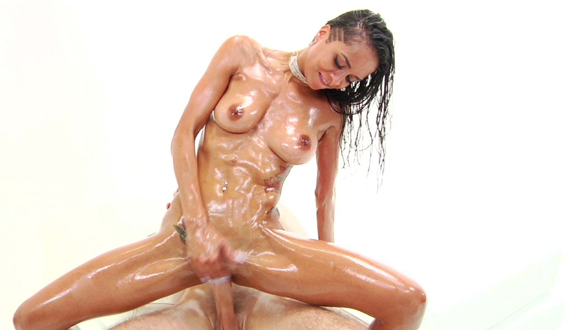 Dirty blonde bitch on heels fisting her oily pussy porn photo
