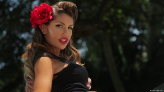Classy Brunette August Ames with a Red Flower in Her Hair and a Black Dress Gets Fucked in and on a Classic Car