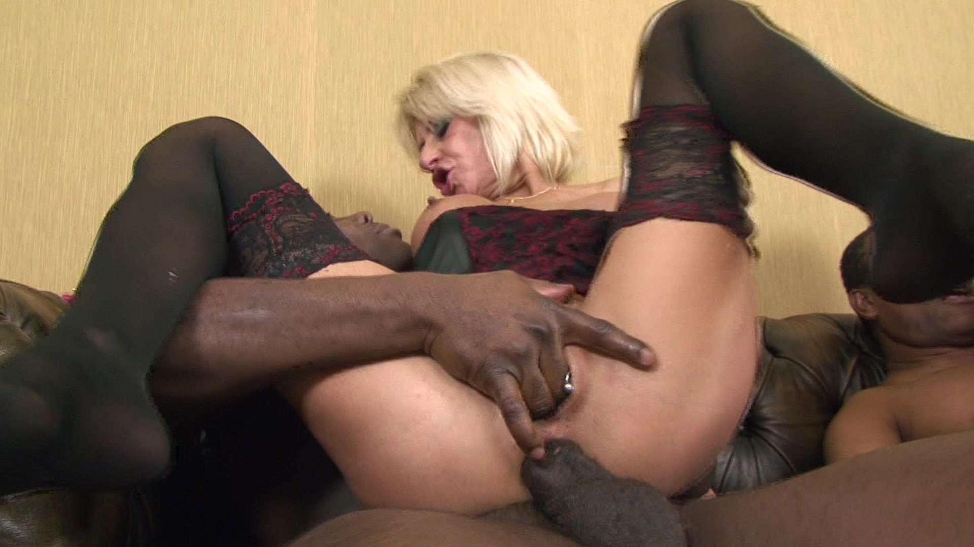 Two milfs swapping a black cock