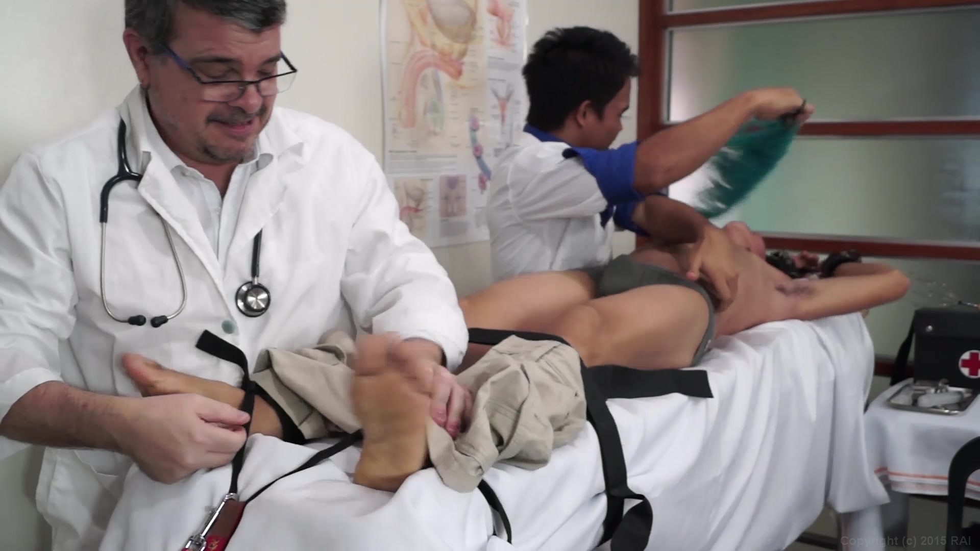 doctor tickles patient