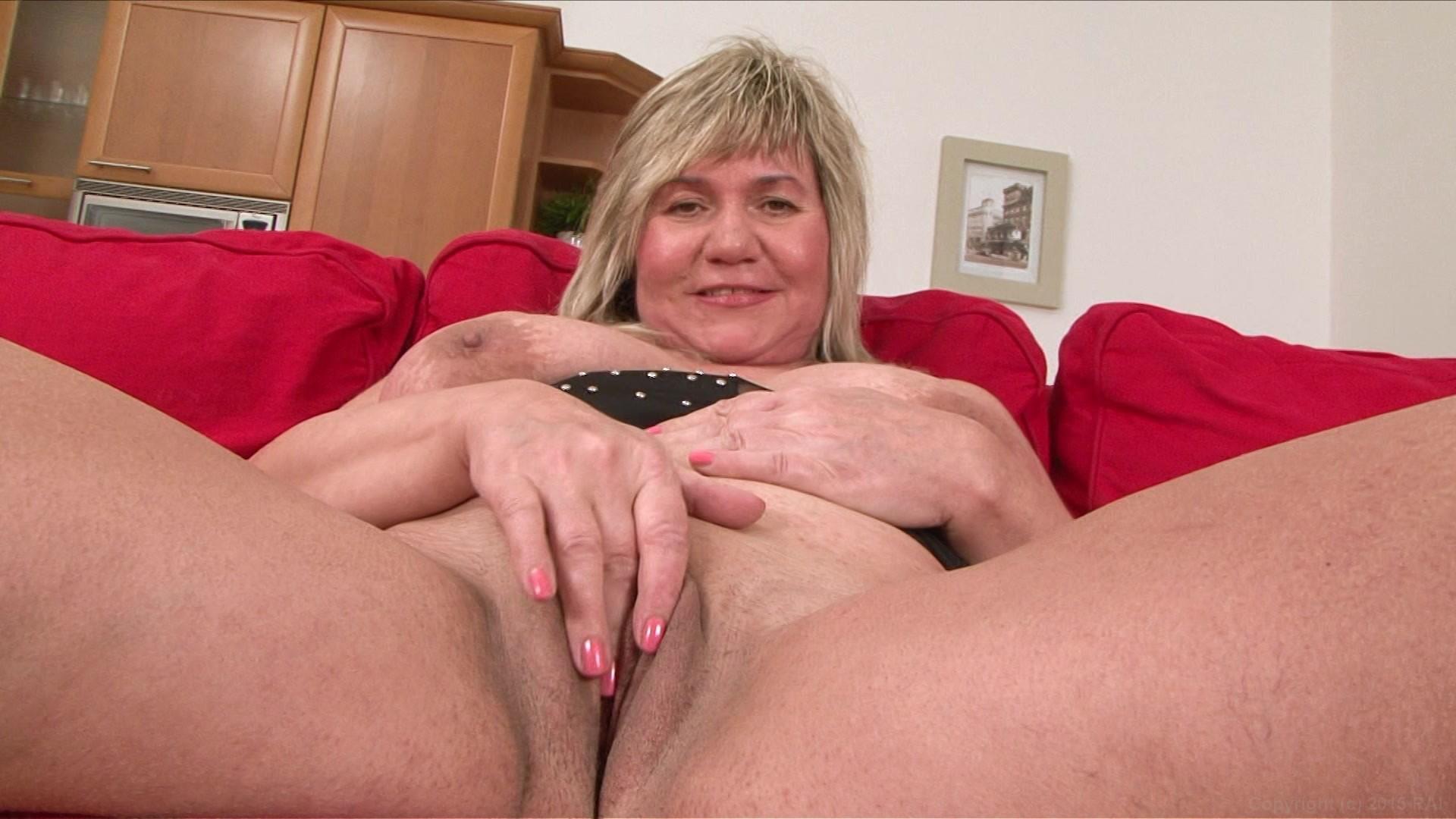 Joyful moment radiant mature blonde lady stock photo