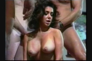 Streaming porn scene video image #6 from Busty brunette gets double pounded at a party