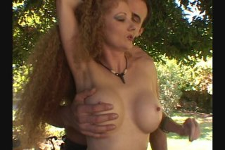 Streaming porn scene video image #1 from Frizzy Haired Big Boobed Nympho is Gangbanged Outdoors