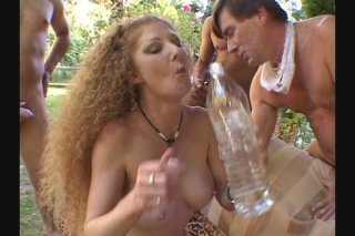 Streaming porn scene video image #3 from Frizzy Haired Big Boobed Nympho is Gangbanged Outdoors