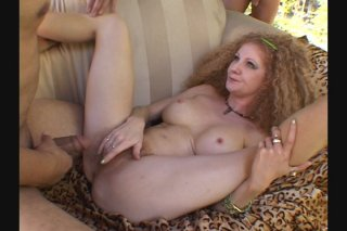 Streaming porn scene video image #4 from Frizzy Haired Big Boobed Nympho is Gangbanged Outdoors