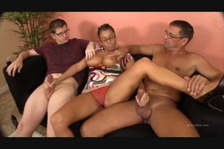 Stacie Starr Gives Them Both a Handjob at the Same Time on the Black Couch